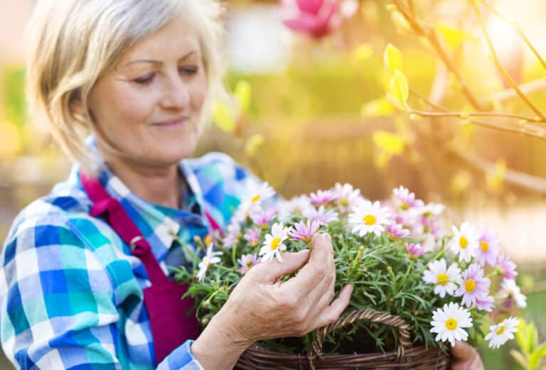 Senior woman gardening flowers